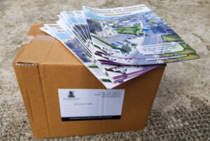 Box of printed newsletters